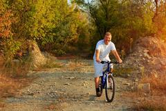 Mountain Bike cyclist riding outdoor - stock photo