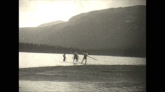 Vintage 16mm film, 1927, Canada, stand up rafting Stock Footage