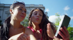 4K Happy attractive female friends posing for selfie outdoors in the city Stock Footage