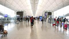 HKG International terminal concourse interior, passengers, white canopy roof Stock Footage