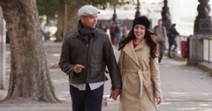 Shot of a happy young couple walking through an urban area together in London. Stock Footage