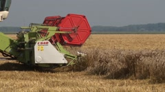 Combine harvester header in field - stock footage