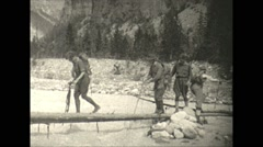 Vintage 16mm film, 1927, Canada, hikers crossing river on log #1 Stock Footage