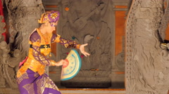 Balinese dancer female performing on stage Stock Footage