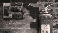 Old electrical panel against a textured wall with a fire extinguisher close by. Stock Footage