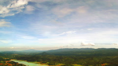 Pan of the Vietnamese countryside on a partly cloudy day. - stock footage
