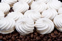 French vanilla meringue cookies and  coffee beans Stock Photos