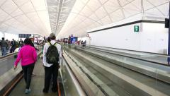 Moving walkway at modern airport, POV travel to departure gate, passengers Stock Footage
