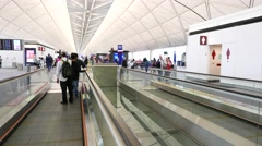 Loud speaker alert at end of moving walkway, please keep clear - stock footage
