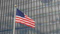 American flag in front of office building. - stock footage