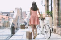 brunette woman with bicycle - stock photo