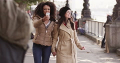 Two young women taking a self-portrait on a cellphone. Shot on RED Epic. Arkistovideo