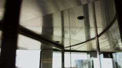 Revolving door in reception of office building Stock Footage