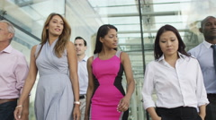 4K Confident female business team walking together outside office building Stock Footage