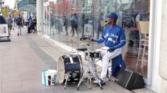 Toronto blue jays street performer drummer Stock Footage