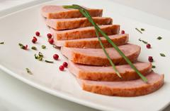 roasted turkey sliced on a white plate - stock photo