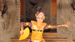 Balinese dancer in traditional costume performing on stage Stock Footage