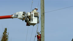 City Hydro Linemen Hammering On New Clips Stock Footage