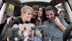 Happy cool  friends making selfie with phone in car Stock Footage