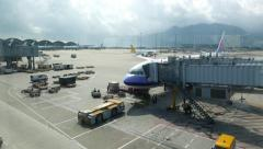 HKG apron area as seen from terminal, airplane connected to jet bridge Stock Footage