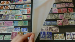Watching an international stamp collection 2 Stock Footage