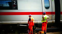 Cologne Köln Koln Koeln 2 Train workers n ICE train passing through Stock Footage