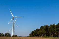many wind turbines rotate - stock photo