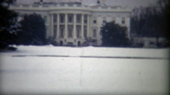 1972: Whitehouse snow covered lawn during winter. Stock Footage