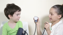 Kids role play in hospital game Stock Footage