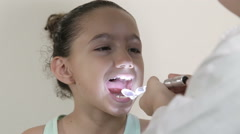 Young girl open her mouth at the dentist Stock Footage