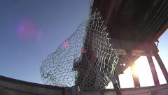 Fishing Net On Boat Going Under Bridge Stock Footage