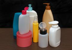 Set of colorful toiletries cosmetic plastic bottles Stock Photos