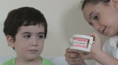 Close up of kids teach each other mouth hygiene Stock Footage