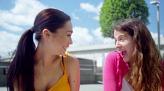 4K Portrait of 2 attractive female friends chatting together outdoors in the cit - stock footage