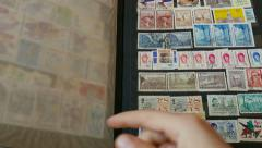 Watching an international stamp collection 3 Stock Footage