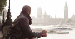 Portrait of an attractive man in London with Big Ben in background. Shot on RED  - stock footage