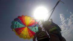 4k Two duplex paragliders paragliding under sun Stock Footage