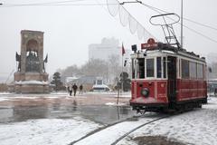 Nostalgic tram when snowfalls at Istanbul,Taksim - stock photo