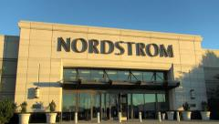 Nordstrom storefront, woman customer enters Stock Footage