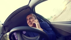 Businessman  man manager in the car talking on phone talks conviction Stock Footage
