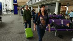 Passengers wait, sit resting, come to departure gate, POV camera walk Stock Footage