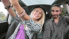 Hipster couple doing selfie in car while driving Stock Footage