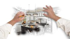 Stock Photo of Male Hands Sketching with Pencil A Custom Kitchen with Photo Showing Through.