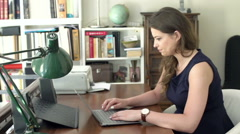 Angry businesswoman working on laptop and hitting it, steadycam shot Stock Footage