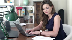 Businesswoman working on laptop and receiving good results, steadycam shot Stock Footage