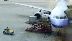 Luggage container lift up and loading into aircraft, flight preparation apron Stock Footage