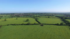 4K Aerial flight above forest & fields in the English countryside.  Stock Footage
