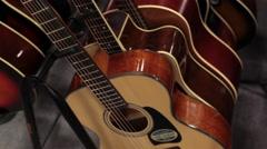 Pan guitars on rack for sale Stock Footage