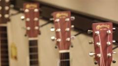 Rack focus guitar headstock Martin acoustic Stock Footage