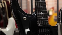Rack focus from one guitar to another static Stock Footage